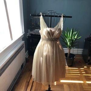 Beige/gold chiffon graduation dress.